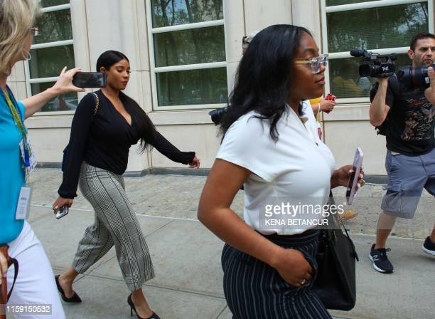 R Kelly's girlfriends Jocelyn Savage and Azriel Clary leave after a hearing in the racketeering and sex trafficking case of Kelly at Brooklyn federal...