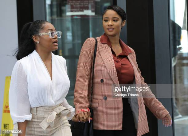 Kelly's girlfriends, left, Azriel Clary and Joycelyn Savage, leave following Kelly's hearing at the Leighton Criminal Court building, Sept. 17, 2019...