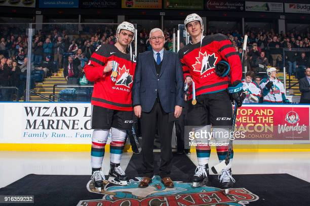 Kelowna Rockets' General Manger Bruce Hamilton stands on the ice between Dillon Dube and Cal Foote of the Kelowna Rockets to acknowledge the gold...