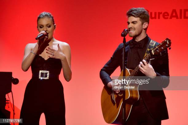 Kelsea Ballerini and Andrew Taggart of The Chainsmokers perform onstage during the amfAR Gala New York 2019 at Cipriani Wall Street on February 06...