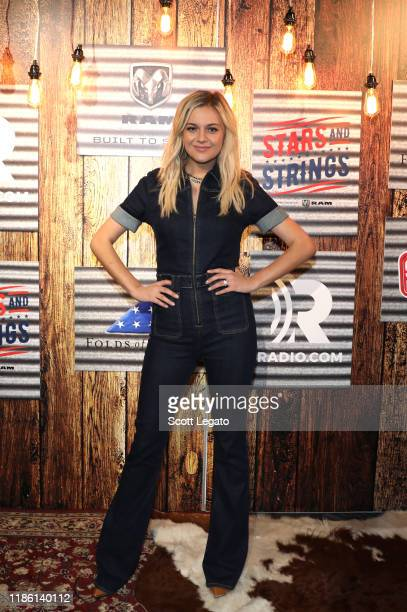 "Kelsea Ballerini poses for a photo during ""Stars and Strings Presented by RAM Trucks Built to Serve,"" a RADIO.COM event, at the Fox Theatre on..."