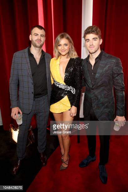 Kelsea Ballerini poses with Alex Pall and Andrew Taggart of The Chainsmokers at the 2018 American Music Awards at Microsoft Theater on October 9 2018...