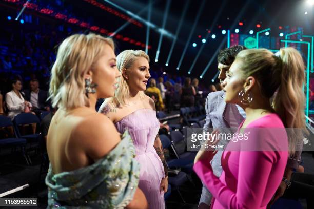 Kelsea Ballerini RaeLynn and Julia Michaels attend the 2019 CMT Music Awards at Bridgestone Arena on June 05 2019 in Nashville Tennessee