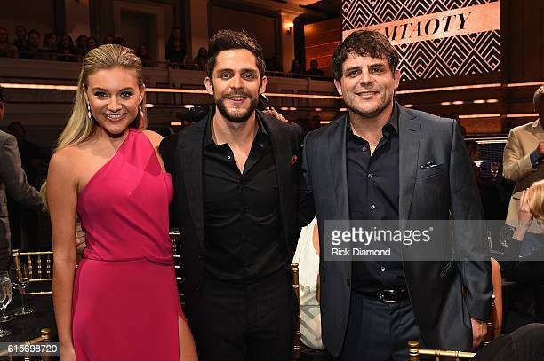 Kelsea Ballerini Thomas Rhett and Rhett Akins take photos during CMT Artists of the Year 2016 on October 19 2016 in Nashville Tennessee