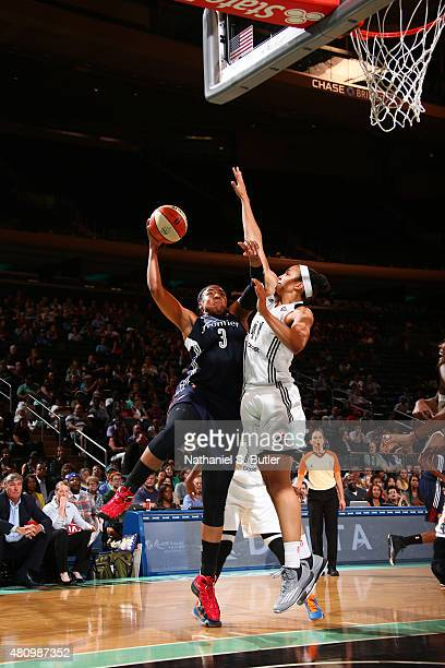 Kelsey Bone of the Connecticut Sun goes for the layup against Kiah Stokes of the New York Liberty during the game on July 16 2015 at Madison Square...