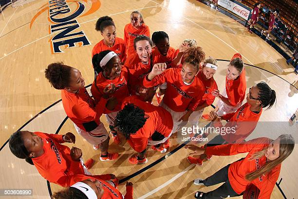 Kelsey Brockway of the Pepperdine Waves smiles for the camera as she huddles with teammates Kayla Blair, Yasmine Robinson-Bacote, Devin Stanback,...
