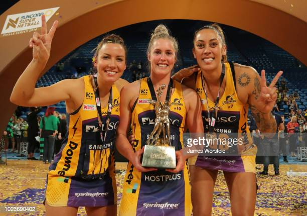 Kelsey Browne Laura Scherian and Erena Mikaere of the Sunshine Coast pose for a photo with the championship trophy after their win Super Netball...