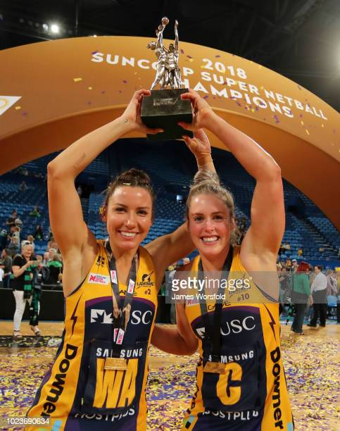 Kelsey Browne Laura Scherian of the Sunshine Coast pose for a photo with their championship trophy after their win Super Netball Grand Final match...