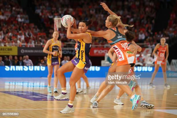 Kelsey Browne of the Lightning catches the ball ahead of JamieLee Price of the Giants during the Super Netball round 1 match between Giants Netball...
