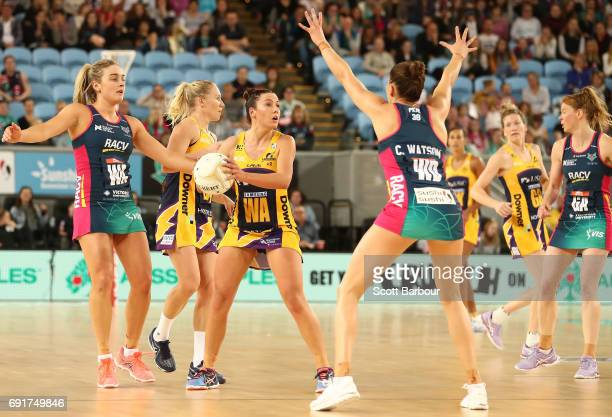 Kelsey Browne of the Lightning passes the ball during the Super Netball Major Semi Final match between the Vixens and the Lightning at Margaret Court...
