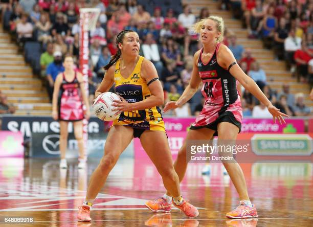 Kelsey Browne of the Lightning passes under pressure during the round three Super Netball match between the Thunderbirds and the Lightning at...