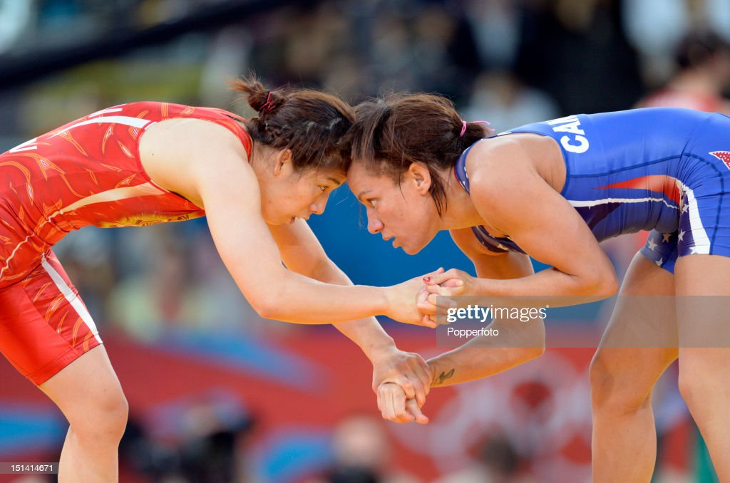 Kelsey Campbell (blue) of the United States and Saori Yoshida of Japan compete in the Women's Freestyle 55 kg Wrestling on Day 13 of the London 2012 Olympic Games at ExCeL on August 9, 2012 in London, England.