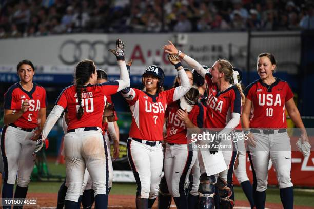 Kelsey Christine Stewart of United States celebrates after hitting a solo home run in the fifth inning against Japan during their Playoff Round match...