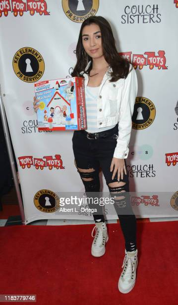 Kelsey Cook attends The Couch Sisters 1st Annual Toys For Tots Toy Drive held onNovember 20 2019 in Glendale California