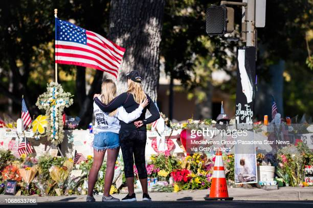 Kelsey Escobar of San Diego, who was friend's with victim Jake Dunham, visits the Borderline Bar & Grill mass shooting memorial in Thousand Oaks with...