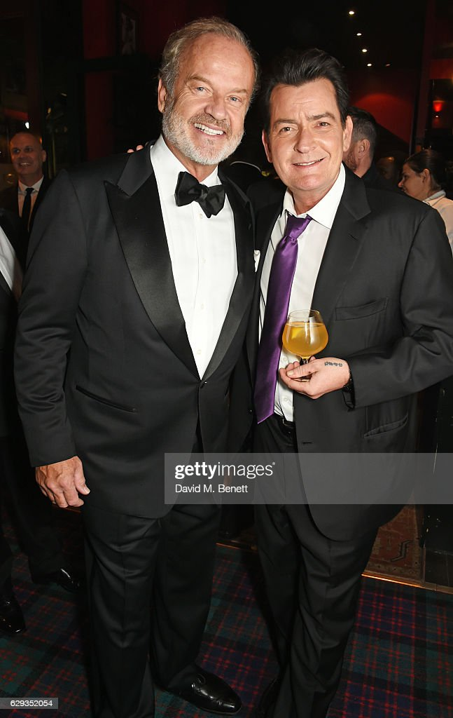 Kelsey Grammer (L) and Charlie Sheen attend the Snow Queen Cigar Smoker of the Year awards at Boisdale of Canary Wharf on December 12, 2016 in London, England.