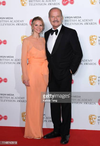 Kelsey Grammer and Kayte Walsh pose in the Press Room at the Virgin TV BAFTA Television Award at The Royal Festival Hall on May 12 2019 in London...