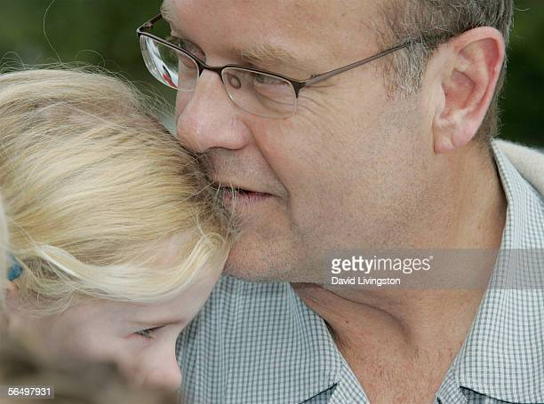 Kelsey Grammer holds his daughter Mason Olivia at the home of John Paul DeJoria, CEO and co-founder of John Paul Mitchell Haircare Systems, during...