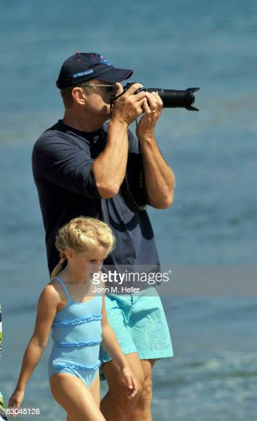 Kelsey Grammer with his youngest daughter Mason Olivia Grammer takes pictures at the Oceana Celebrity Free Expression Session Free Surf Competition...