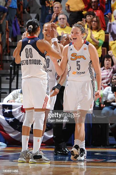 Kelsey Griffin of the Connecticut Sun celebrates with Iziane Castro Marques after defeating the Indiana Fever on September 15 2013 at the Mohegan Sun...