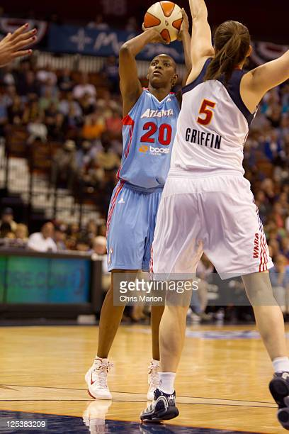 Kelsey Griffin of the Connecticut Sun defends Sancho Lyttle of the Atlanta Dream in Game One of the Eastern Conference Semifinals during the 2011...