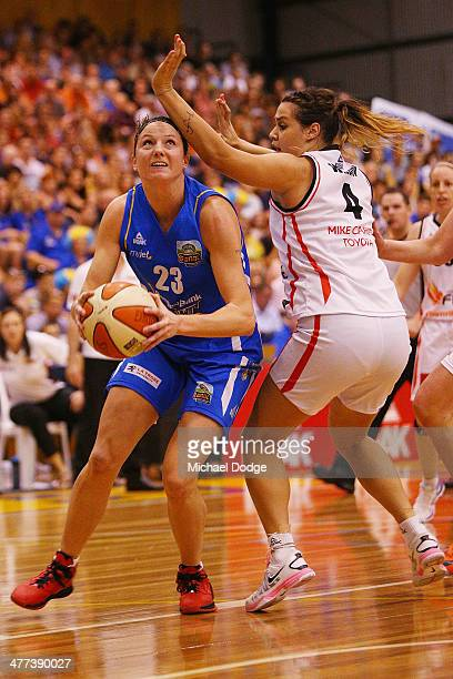 Kelsey Griffin of the Spirit drives to the basket past Alex Wilson of the Fire during the WNBL Grand Final match between Bendigo Spirit and...