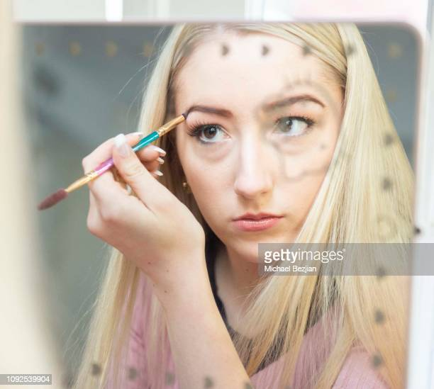 Kelsey Lee getting ready using Moonstar Beauty at Giveback Day at TAP The Artists Project on January 10 2019 in Los Angeles California