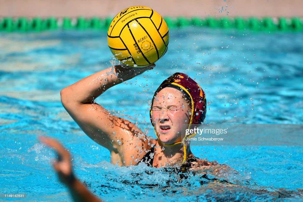 a88ca4c5 Kelsey McIntosh of the USC Trojans gets splashed in the face against ...