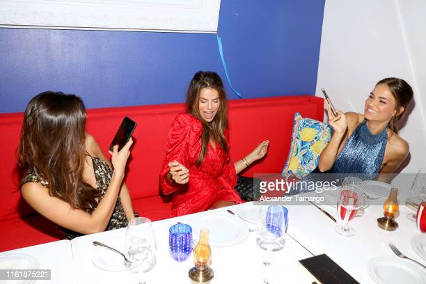 Kelsey Merritt Brooks Nader and Robin Holzken attend a Sports Illustrated Swimsuit Event during Miami Swim Week at Amare Ristorante on July 13 2019...