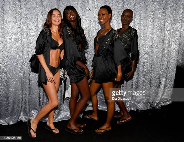 Kelsey Merritt Duckie Thot Herieth Paul and Grace Bol pose backstage during the 2018 Victoria's Secret Fashion Show at Pier 94 on November 8 2018 in...