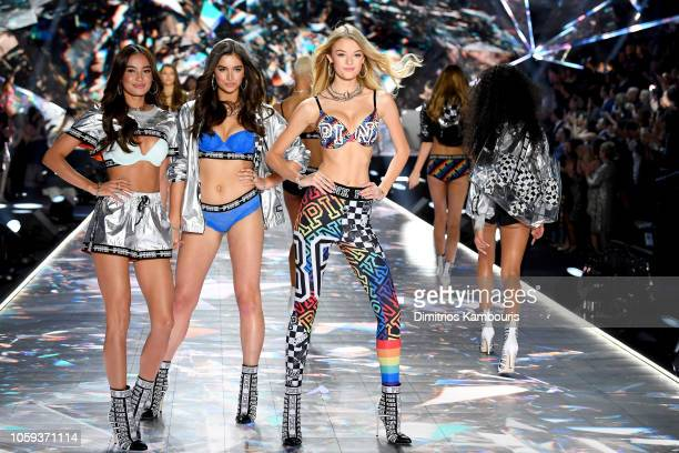 Kelsey Merritt Maia Cotton and Willow Hand walk the runway during the 2018 Victoria's Secret Fashion Show at Pier 94 on November 8 2018 in New York...