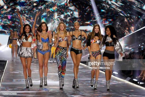 Kelsey Merritt Maia Cotton Willow Hand Iesha Hodges Myrthe Bolt and Melie Tiacoh walk the runway in the 2018 Victoria's Secret Fashion Show at Pier...