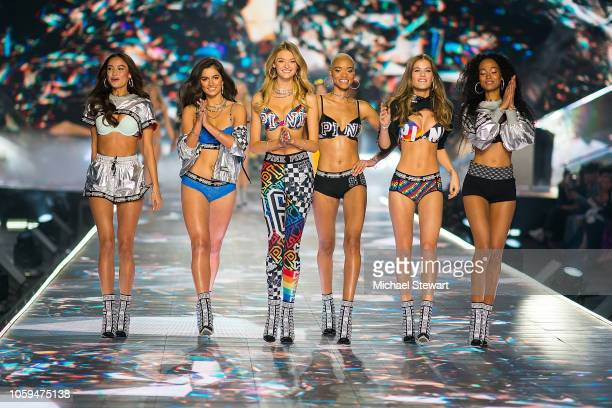 Kelsey Merritt Maia Cotton Willow Hand Iesha Hodges Myrthe Bolt and Melie Tiacoh walk the runway during the 2018 Victoria's Secret Fashion Show at...