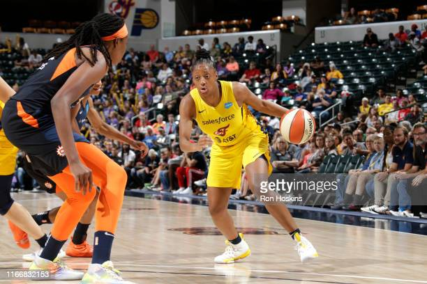 Kelsey Mitchell of the Indiana Fever drives to the basket against the Connecticut Sun on September 8, 2019 at the Bankers Life Fieldhouse in...