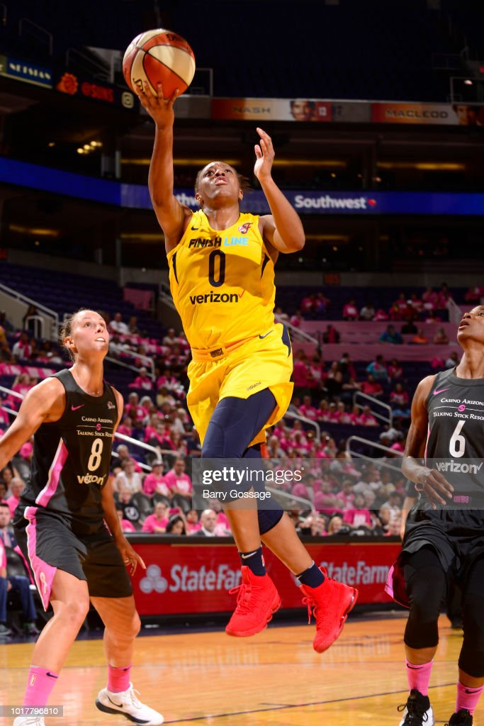 PHOENIX, AZ - AUGUST 10; Kelsey Mitchell #0 of the Indiana Fever goes to the basket against the Phoenix Mercury on August 10, 2018 at Talking Stick Resort Arena in Phoenix, Arizona.