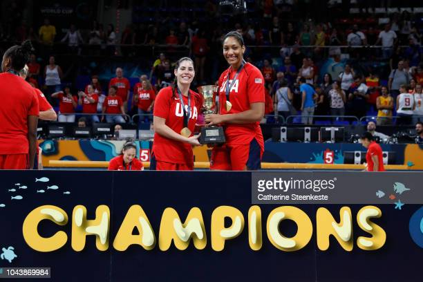 Kelsey Plum and A'ja Wilson of the USA National Team pose with championship trophy after defeating the Australia team during the Gold Medal Game of...