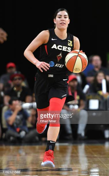 Kelsey Plum of the Las Vegas Aces brings the ball up the court against the Los Angeles Sparks during their game at the Mandalay Bay Events Center on...