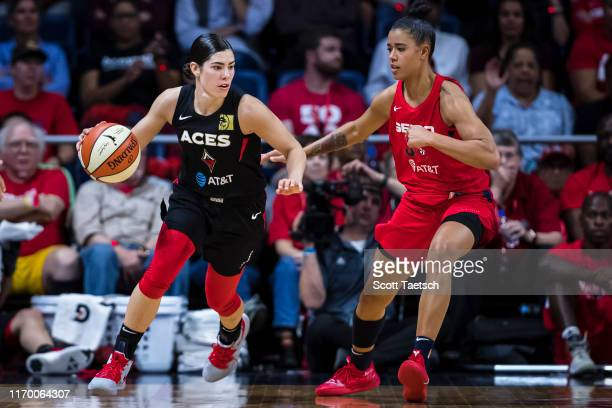 Kelsey Plum of the Las Vegas Aces dribbles the ball against Natasha Cloud of the Washington Mystics during the second half of Game Two of the 2019...