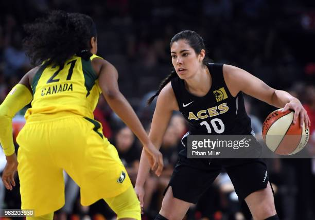 Kelsey Plum of the Las Vegas Aces is guarded by Jordin Canada of the Seattle Storm during the Aces' inaugural regularseason home opener at the...