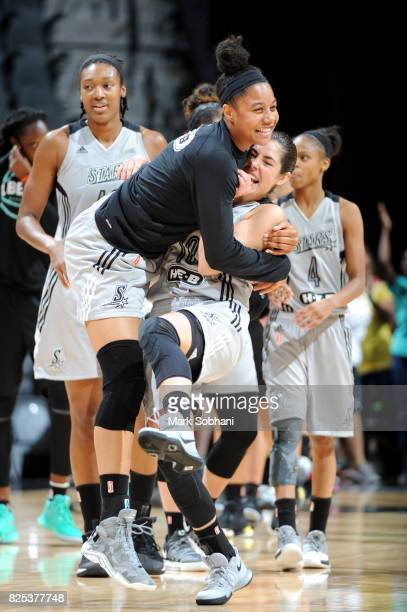 Kelsey Plum of the San Antonio Stars and Nia Coffey of the San Antonio Stars react after the game against the New York Liberty during a WNBA game on...