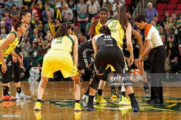 Kelsey Plum of the San Antonio Stars and Sue Bird of the Seattle Storm wait for the tipoff on June 18 2017 at KeyArena in Seattle Washington NOTE TO...