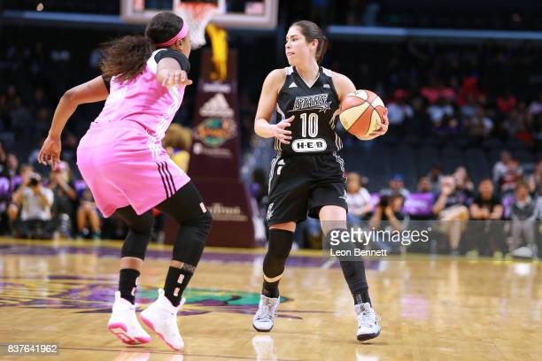 Kelsey Plum of the San Antonio Stars handles the ball against Odyssey Sims of the Los Angeles Sparks during a WNBA game at Staples Center on August...
