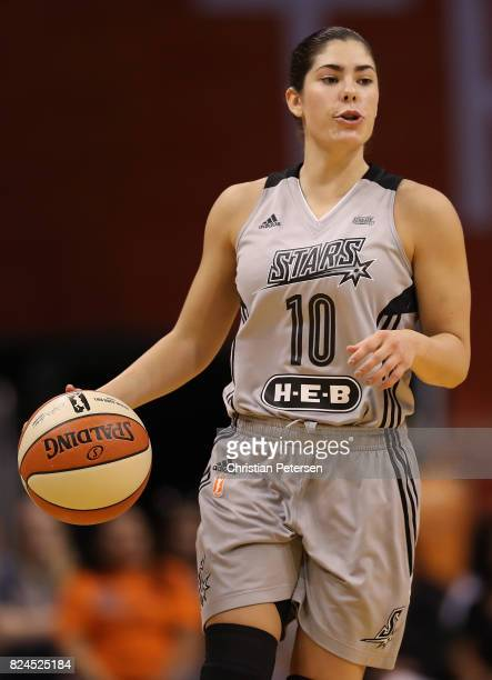 Kelsey Plum of the San Antonio Stars handles the ball during the first half of the WNBA game against the Phoenix Mercury at Talking Stick Resort...