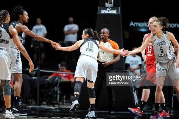 Kelsey Plum of the San Antonio Stars high fives Kayla Alexander and Dearica Hamby of the San Antonio Stars during the game against the Washington...