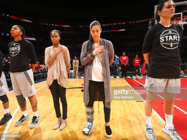 Kelsey Plum of the San Antonio Stars stands for the national anthem before the game against the Washington Mystics on May 14 2017 at Verizon Center...