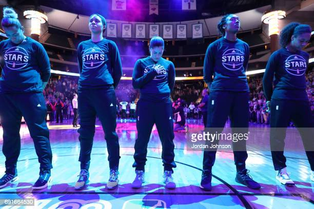 Kelsey Plum of the San Antonio Stars stands for the National Anthem before a game against the Minnesota Lynx on May 28 2017 at Xcel Energy Center in...