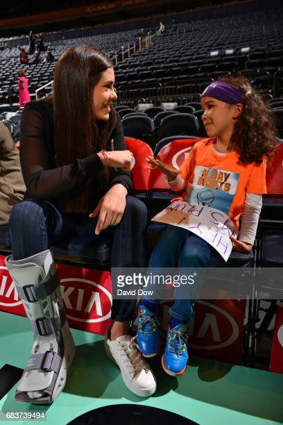 Kelsey Plum of the San Antonio Stars talks with a young fan before the game against the New York Liberty at Madison Square Garden on May 13 2017 in...