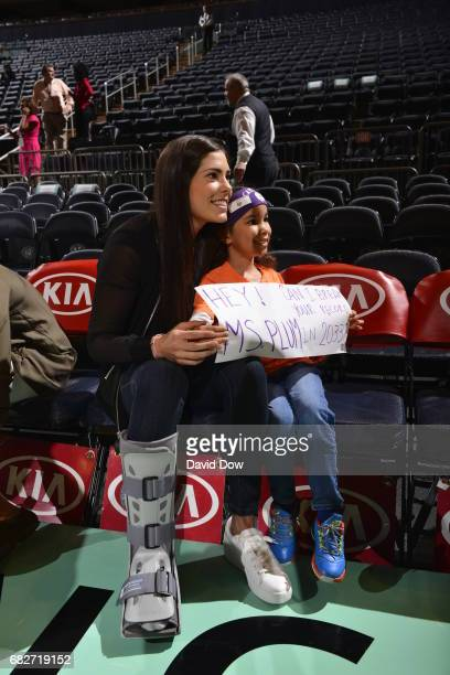 Kelsey Plum of the San Antonio Stars with a young fan before the game against the New York Liberty at Madison Square Garden on May 13 2017 in New...