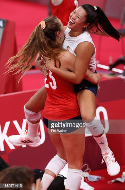 Kelsey Robinson and Justine Wong-Orantes of Team United States react after defeating Team Brazil during the Women's Gold Medal Match on day sixteen...