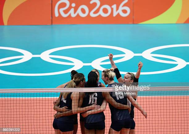 Kelsey Robinson and Kimberly Hill of United States celebrate a point during the Women's Bronze Medal Match between Netherlands and the United States...